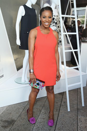 A psychedelic-print box clutch finished off June Ambrose's multi-hued look.
