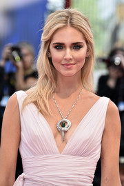Chiara Ferragni accessorized with a statement-making Bulgari Serpenti diamond pendant.