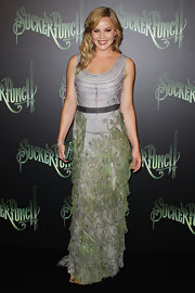 Abbie Cornish went for muted hues in her tiered gown at the Sydney Sucker Punch premiere. The actress complimented the dress with a green sparkling hard case clutch and opted to wear her blond locks down in waves.