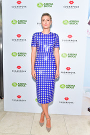 Maria Sharapova was eye candy in a shiny blue gingham-print dress at the launch of Sugarpova in Moscow.