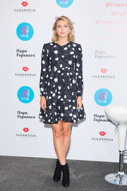 Maria Sharapova launched Sugarpova in Moscow wearing a black-and-white floral mini dress.