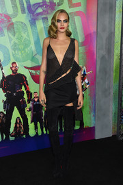 Cara Delevingne kept the fierceness coming with a pair of black thigh-high boots by Christian Louboutin.