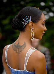 Jourdan Dunn styled her hair into a braided bun with multiple blue and silver bobby pins for the 2019 Serpentine Gallery Summer Party.