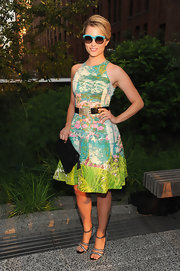 "Dianna Agron looked sweet and summery at the Coach soiree in this colorful ""Revisited Impressionist Dress."""