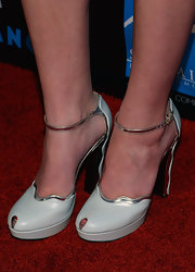Hailee's pale blue pumps featured a tiny peep toe, a retro ankle strap, and fun curves that totally complemented the curves of her printed paisley ensemble.