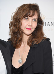 Maggie Gyllenhaal wore shoulder-length curls with side-swept bangs when she attended the Broadway opening of 'Sunday in the Park with George.'