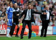 Andre Villas Boas always dresses to impress at Chelsea matches... here wearing a suit and thin tie.