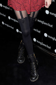 Poppy Delevigne showed off her military style by donning a cute pair of combat boots. She paired her grunge boots with a daring pair of tights. What a contrast!