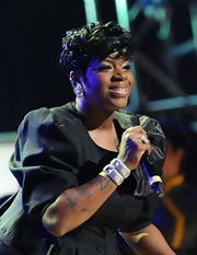 Fantasia Barrino wore a pair of paved and jeweled bangle bracelets at the 2012 Super Bowl.