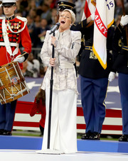 Pink sang the National Anthem at the Super Bowl LII pre-game show wearing white wide-leg pants, a camo top, and a bomber jacket.