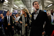 Gisele wore a patterned giraffe scarf while walking with her husband after his Super Bowl loss.