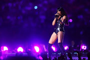 Kelly brought it at the Super Bowl in this black leather bodysuit.