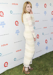 Emma Roberts gave her white maxi dress a girly finish at the Super Saturday 14 to Benefit OCRF with a pair of summery wooden platforms. The chunky heels gave her look a girly finish thanks to their sweet bows.
