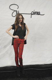 Coco Rocha paired her fierce animal-print skinny jeans with slouchy black ankle boots.