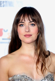 Dakota Johnson attended the BFI London Film Festival premiere of 'Suspiria' wearing her usual loose hairstyle with wispy bangs.