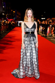 Mia Goth shone in a tiered silver lame gown by Givenchy Couture at the BFI London Film Festival premiere of 'Suspiria.'