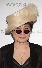 Yoko Ono wore a layered straw hat with feather details when she attended the Swarovski Celebration of Crystal and Art.