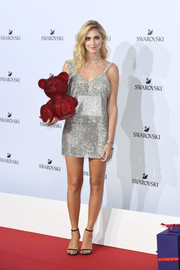 Chiara Ferragni looked totally festive in a fully embellished silver mini dress at the Swarovski Crystal Wonderland party.