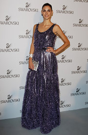 Melissa glittered in a playful purple evening gown at the Swarovski event in Milan.