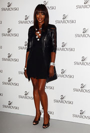 Naomi rocked a black leather coat over her LBD for the Swarovski event.