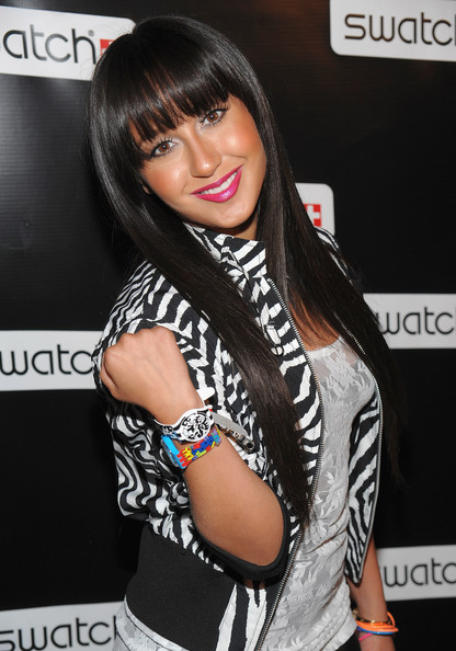 Adrienne wears two Swatch watches to celebrate the CreArt Collection.
