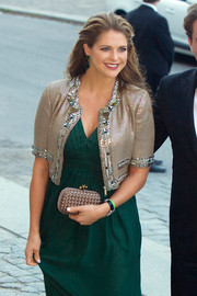 Princess Madeleine's emerald earrings matched perfectly with her dress.