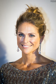 Princess Madeleine attended the World Childhood Foundation's 20th anniversary wearing her hair in a messy-glam updo.