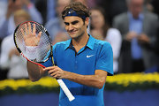 Tennis pro Roger Federer makes his sponsor proud with this Nike-emblazoned colored top.
