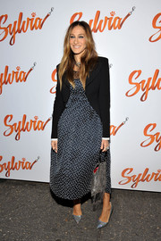 Sarah Jessica Parker attended the opening of 'Sylvia' wearing a navy Dior polka-dot dress under a black blazer.