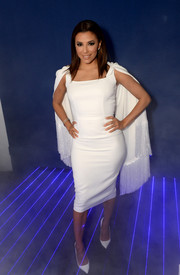 Eva Longoria rocked a little white dress with a fringed cape during the Symphony in Blue event.