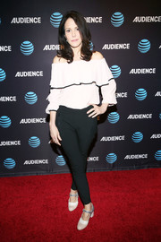 Mary-Louise Parker paired her blouse with black cigarette pants.