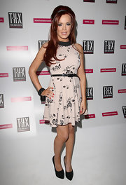 Maria Fowler looked unusually demure in a beige print dress at the T-H-X launch party.