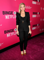 Brittany Snow made a stylish appearance at the T-Mobile Un-carrier X launch in a fitted black pantsuit teamed with a crop-top.