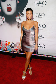 Kourtney Kardashian oozed sex appeal wearing this iridescent slip dress by Area at the TAO Chicago grand opening.