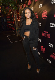 Karrueche Tran was edgy-sexy in a black lace-up denim jacket layered over a bandeau top at the 'Drop the Mic' and 'The Joker's Wild' premiere party.