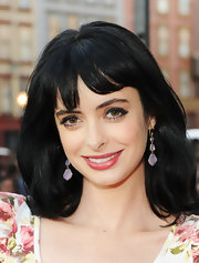 Actress Krysten Ritter attended a screening party hosted by Twentieth Century Fox wearing 18-karat gold modern rock candy 3 tier Snowman earrings in blue chalcedony.