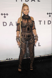 Beyonce Knowles turned up the heat in a sheer, beaded black gown by Gattinoni Couture during Tidal X: 1015.