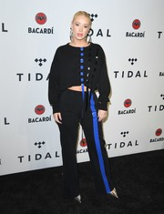 A pair of black pants with a blue stripe running down one leg sealed off Iggy Azalea's athleisure look.