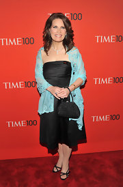 Michele wore a black strapless dress with an aqua shawl for the Time 100 Gala.