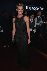 Faith Hill was classy and sophisticated at the Time 100 Gala in a black Armani Prive lace gown featuring a racer neckline and a gemstone-embellished sash.