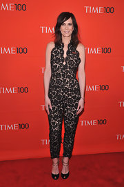 Kristen Wiig arrived at the 'Time' 100 Gala wearing a pair of black peep toe pumps featuring gold chain straps.