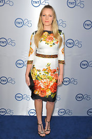 Emma Bell brought out the oversize-prints with this orange, red, and yellow floral shift.