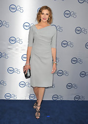 Brenda Strong stuck to a more sophisticated look with this light gray dress that featured an asymmetrical neckline.