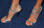 Angie matched her silver strappy sandals to her studded clutch at the TNT 25th Anniversary Party.