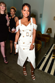 Christina Milian complemented her dress with white triple-strap sandals.