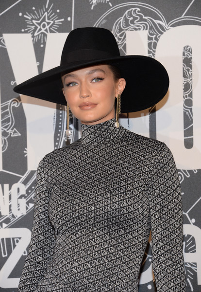 Gigi Hadid looked chic wearing this wide-brimmed black hat at the TOMMYNOW New York Fall 2019 show.