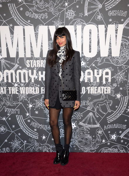 Jameela Jamil finished off her outfit with black patent boots.