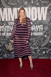 Iskra Lawrence teamed her frock with a pair of snakeskin-print platform pumps.