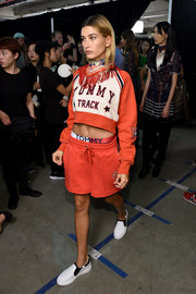 Hailey Baldwin matched her top with a pair of coral shorts.