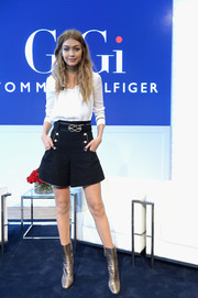 Navy shorts with gold buttons sealed off Gigi Hadid's cute outfit.
